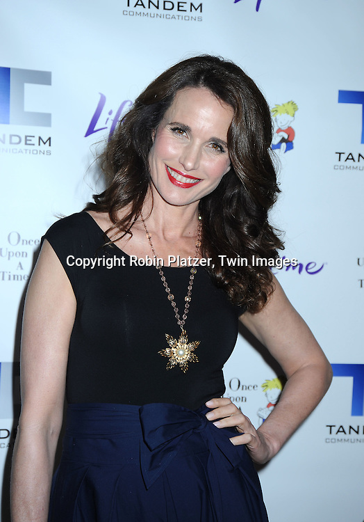 "actress Andie MacDowell in Donna Karan outfit posing for photographers at The Lifetime Television screening of Patricia Cornwell's novel ""The Front"" starring Daniel Sunjata, Andie MacDowell and Ashley Williams at The Hearst Tower on April 7, 2010."