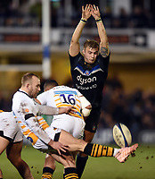 Jack Walker of Bath Rugby looks to charge down a kick from Dan Robson of Wasps. Heineken Champions Cup match, between Bath Rugby and Wasps on January 12, 2019 at the Recreation Ground in Bath, England. Photo by: Patrick Khachfe / Onside Images
