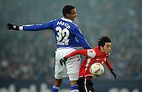 FUSSBALL   1. BUNDESLIGA   SAISON 2011/2012   20. SPIELTAG FC Schalke 04 - FSV Mainz 05                                  04.02.2012 Joel Matip (li, FC Schalke 04) gegen Yunus Malli (re, Mainz)