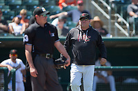 Sacramento RiverCats pitching coach Steve Kline argues with the home plate umpire Clayton Hamm during a Pacific Coast League against the Tacoma Rainiers at Raley Field on May 15, 2018 in Sacramento, California. Tacoma defeated Sacramento 8-5. (Zachary Lucy/Four Seam Images)