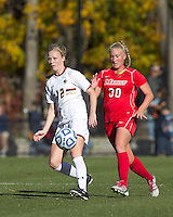 Boston College midfielder Julia Bouchelle (12) one time pass as Marist College midfielder Melanie Rigo (30) closes. Boston College defeated Marist College, 6-1, in NCAA tournament play at Newton Campus Field, November 13, 2011.