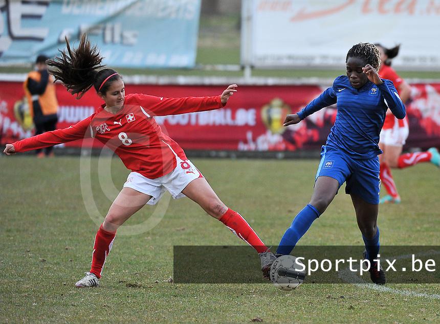 Switzerland U19 - France U19 : Swiss Aline Stöckli in a duel with French Griedge M'Bock Bathy (C) (right).foto DAVID CATRY / Nikonpro.be