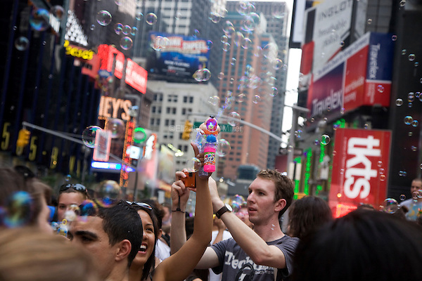 "Loosely based on Dr. Seuss book ""The Butter Battle Book,"" people converge in New York City's Times Square for Bubble Battle NYC on 26 June 2010, blowing bubbles with toys, bubble solution, and other bubble generators."