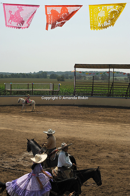Participants in the rodeo ring during the Mexican rodeo Charros del Norte in Lowell, Indiana on July 27, 2008.