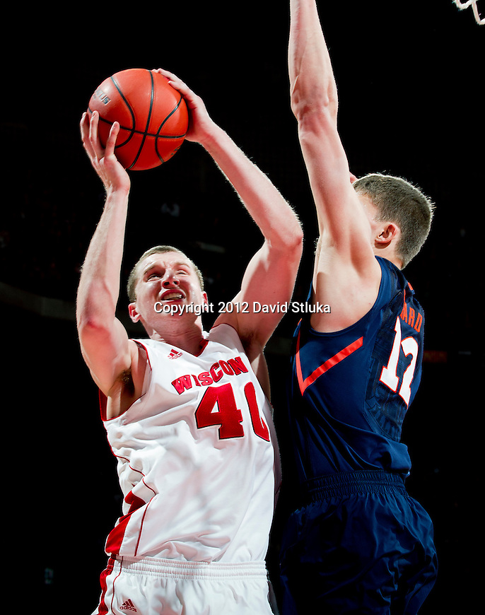 Illinois Fighting Illini center Meyers Leonard (12) defends against Wisconsin Badgers forward Jared Berggren (40) during a Big Ten Conference NCAA college basketball game on Sunday, March 4, 2012 in Madison, Wisconsin. The Badgers won 70-56. (Photo by David Stluka)