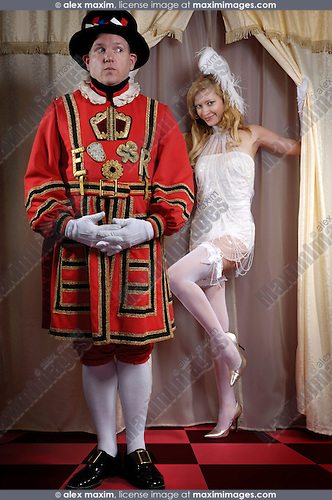 Yeomen of the Guard - Beefeater looking sideways at a beautiful young lady appearing from behind of a curtain