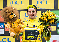 Picture by Alex Broadway/SWpix.com - 10/03/2018 - Cycling - 2018 Paris Nice - Stage Seven - Nice to Valdeblore La Colmiane - Simon Yates of Mitchelton Scott on the podium after taking the overall lead and yellow jersey.<br /> <br /> NOTE : FOR EDITORIAL USE ONLY. THIS IS A COPYRIGHT PICTURE OF ASO. A MANDATORY CREDIT IS REQUIRED WHEN USED WITH NO EXCEPTIONS to ASO/Alex Broadway MANDATORY CREDIT/BYLINE : ALEX BROADWAY/ASO