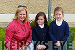 Michelle Murphy with junior infants Emma Buckley and Grace Cronin on their first day of school in Shrone NS Rathmore on Monday