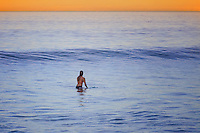 Female Surfer Waiting for a Wave to Ride
