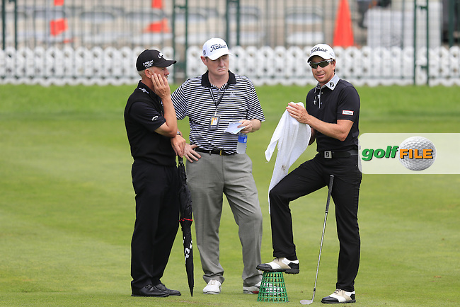 Brett Rumford (AUS) with coaches Pete Cowan and Warren Kennaugh on the practice range during Wednesday's Practice Day of the 2013 Bridgestone Invitational WGC tournament held at the Firestone Country Club, Akron, Ohio. 31st July 2013.<br /> Picture: Eoin Clarke www.golffile.ie