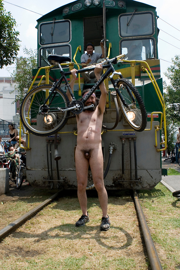 Jorge Neyra, 36 years old, manages to temporarily stop a freight train by blocking its way. Mexico City, on Saturday, June 9, 2007. An estimated 100 people participated in this protest designed to force cardrivers to be more concietious of vulnerable bike riders.