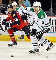 Dallas Stars' Jamie Oleksiak, right, moves the puck out of the Stars zone during the second period of an NHL preseason hockey game against the Florida Panthers, Friday, Sept. 20, 2013, in San Antonio, Texas. (Darren Abate/DA Media)