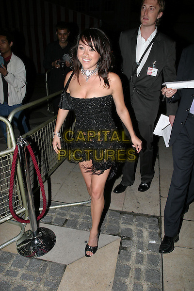 LISA SCOTT LEE.FHM 100 Sexiest Women Party, Guildhall, .London,.3rd June 2004..full length full-length walking black strapless tassels see through.www.capitalpictures.com.sales@capitalpictures.com.©Capital Pictures