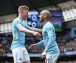 David Silva of Manchester City celebrates scoring the first with Kevin De Bruyne of Manchester City during the premier league match at the Etihad Stadium, Manchester. Picture date 22nd April 2018. Picture credit should read: Simon Bellis/Sportimage