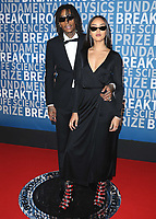 MOUNTAIN VIEW, CA - DECEMBER 3:  Wiz Kalifa and Izabela Guedes at the 6th Annual Breakthrough Prize at NASA Ames Research Center on December 3, 2017 in Mountain View, California. (Photo by Scott Kirkland/NatGeo/PictureGroup)