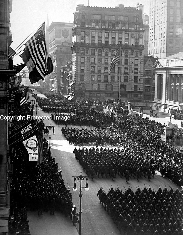 Overseas men welcomed home.  Parade in honor of returned fighters passing the Public Library, N.Y. City.  1919.  Paul Thompson. (War Dept.)<br /> Exact Date Shot Unknown<br /> NARA FILE #:  165-WW-127-27<br /> WAR &amp; CONFLICT BOOK #:  720