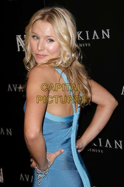 KRISTEN BELL .At The Avakian Beverly Hills Boutique Celebrationat Beverly Hills in Beverly Hills, California on December 4th 2008.                                                                     .half length Herve Leger bodycon dress tight fitted blue back over shoulder rear behind hands on hips.CAP/DVS.©Debbie VanStory/Capital Pictures