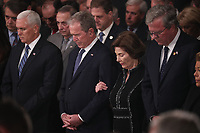 Former President George W. Bush stands with his wife former first lady Laura Bush as the casket of his father former President George H.W. Bush arrives to lie in state in the U.S. Capitol Rotunda in Washington, U.S., December 3, 2018. <br /> CAP/MPI/RS<br /> &copy;RS/MPI/Capital Pictures
