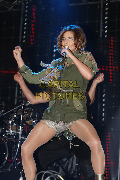 CHERYL COLE .Performs live during Radio One's Big Weekend, Bangor, North Wales, .UK, May 22nd 2010..1 1's music live on stage concert gig half length microphone singing  green khaki parka jacket coat grey gray silver shorts 3/4 hand arm dancing  .CAP/MAR.© Martin Harris/Capital Pictures.