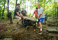 NWA Democrat-Gazette/BEN GOFF @NWABENGOFF<br /> John Sage (from left) of Fayetteville, Ed Faust and son Jared Faust of Fayetteville, and Brooks Booher of Bentonville volunteer with Ozarks Off Road Cyclists to add rock armoring Saturday, July 6, 2019, at the intersection of Last Call and Terrapin Station at Kessler Mountain Regional Park in Fayetteville. Volunteers used 11 tons of stone to shore up the often muddy and erosion-damaged section of the trail and recently completed similar projects on other trails at the park. The Ozark Off Road Cyclists, the local chapter of the International Mountain Bicycling Association, are raising funds through their Kessler Campaign to fund further improvements and future trails at the park.