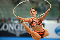 Mojca Rode of Slovenia split leaps to recatch hoop during seniors All-Around competition at 2008 European Championships at Torino, Italy on June 6, 2008.  Photo by Tom Theobald.