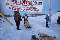 Conway Seavey crosses the finish line of the 2014 Jr. Iditarod Sled Dog Race in first place at Happy Trails Kennel, Big Lake, Alaska<br /> Sunday February 23, 2014 <br /> <br /> Junior Iditarod Sled Dog Race 2014<br /> PHOTO BY JEFF SCHULTZ/IDITARODPHOTOS.COM  USE ONLY WITH PERMISSION
