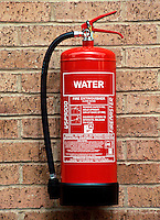 Fire extinguisher containing 9 litres of water. This is used for wood, paper, textiles and similar class A fires...© SHOUT. THIS PICTURE MUST ONLY BE USED TO ILLUSTRATE THE EMERGENCY SERVICES IN A POSITIVE MANNER. CONTACT JOHN CALLAN. Exact date unknown.john@shoutpictures.com.www.shoutpictures.com.