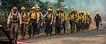 August 20, 1992 Angels Camp, California -- Old Gulch Fire—  Fulton Hotshots hike back from fire line to regroup. The Old Gulch Fire raged over some 18,000 acres, destroying 42 homes while threatening the Mother Lode communities of Murphys, Sheep Ranch, Avery and Forest Meadows.