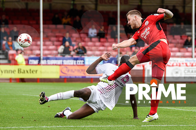 James Collins of Crawley Town (19) Shoots and hits the post before Crawley Town Score their equalising goal  during the Sky Bet League 2 match between Crawley Town and Barnet at Broadfield Stadium, Crawley, England on 20 August 2016. Photo by Edward Thomas / PRiME Media Images.