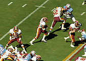 Washington Redskins kick returner Ken Jenkins (31) returns a kick during the game against the Houston Oilers at RFK Stadium in Washington, DC on September 16, 1985.  Among the blockers for Jenkins are: Redskins defensive back Barry Wilburn (45), middle linebacker Neal Olkewicz (52), and right cornerback Vernon Dean (32). The Redskins won the game 16 - 13.  <br /> Credit: Howard L. Sachs / CNP