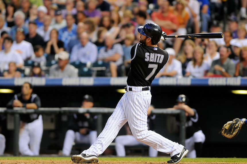 19 JUNE 2010: Colorado Rockies left fielder Seth Smith hits a 2-run homerun during a regular season Major League Baseball game between the Colorado Rockies and the Milwaukee Brewers at Coors Field in Denver, Colorado.   The Rockies beat the Brewers 8-7. *****For Editorial Use Only*****