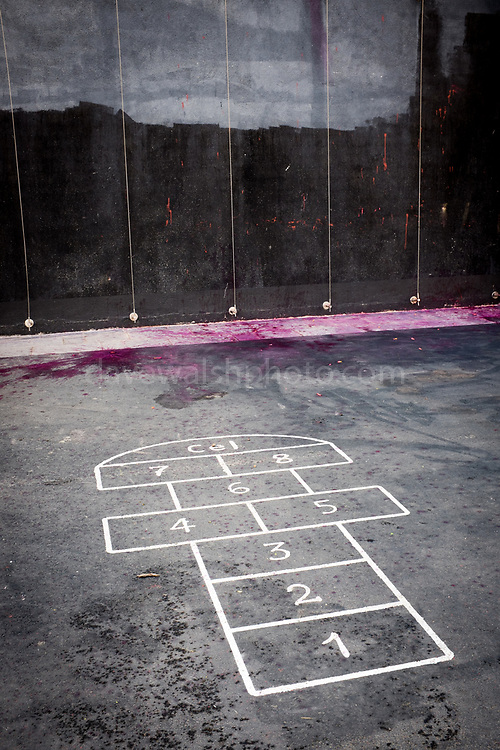"Paint near children's hopscotch at town hall, or ajuntament, of Sant Cugat del Valles, Barcelona. The paint was thrown at a poster, which replaces an earlier one torn down by far-right protestors, reads ""Liibertat Presos Politics"" - Freedom for Political Prisoners in support of Catalan government ministers and civil society leaders jailed by Spanish government.  This version has been bombarded with paint bombs."
