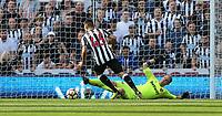 Newcastle United's Aleksandar Mitrovic goes past West Ham United's Joe Hart before scoring his side's third goal <br /> <br /> Photographer Rob Newell/CameraSport<br /> <br /> The Premier League - Newcastle United v West Ham United - Saturday 26th August 2017 - St James' Park - Newcastle<br /> <br /> World Copyright &copy; 2017 CameraSport. All rights reserved. 43 Linden Ave. Countesthorpe. Leicester. England. LE8 5PG - Tel: +44 (0) 116 277 4147 - admin@camerasport.com - www.camerasport.com