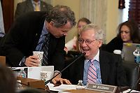 Senator Sherrod Brown, Democrat of Ohio, speaks with Senate Majority Leader Mitch McConnell, Republican of Kentucky, during a mark up of the proposed 2019 Farm Bill at the United States Capitol in Washington, DC on June 13, 2018. Credit: Alex Edelman / CNP /MediaPunch