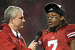 Matt Lepay interviews Wisconsin Badgers defensive back Aaron Henry (7) during the Big Ten Conference Leaders Division Trophy presentation after an NCAA Big Ten Conference college football game against the Penn State Nittany Lions on November 26, 2011 in Madison, Wisconsin. The Badgers won 45-7. (Photo by David Stluka)