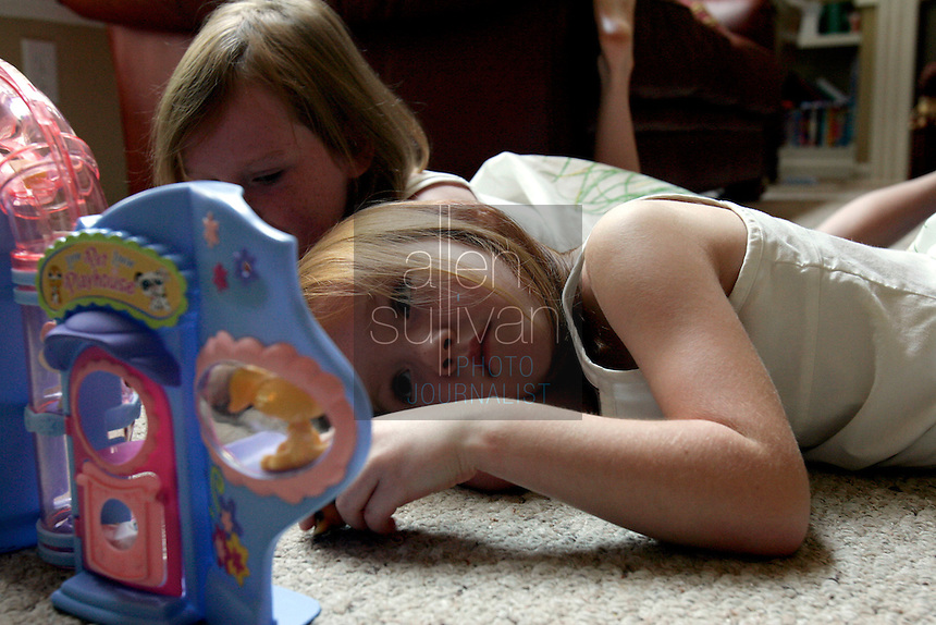 Abigayle Wood, 5, plays with her eight-year-old sister Caroline at home in Lawrenceville, Ga. on Sunday, Sept. 10, 2006. Abigayle was born on Sept. 11, 2001. Her mother, Anna Marie Wood, said the attacks on that day caused an early labor.<br />