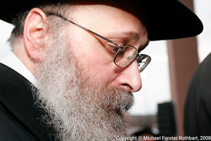 Rabbi Yona Matusof, director of Chabad House of Madison, Wis., reflects during the traditional Chasidic wedding of his daughter Chanie Matusof to Nissi Gansbourg in Middleton, Wis.<br /> <br /> Client: Wisconsin State Journal<br /> &copy; Michael Forster Rothbart<br /> www.mfrphoto.com <br /> 607-267-4893 o 607-432-5984<br /> 5 Draper St, Oneonta, NY 13820<br /> 86 Three Mile Pond Rd, Vassalboro, ME 04989<br /> info@mfrphoto.com<br /> Photo by: Michael Forster Rothbart<br /> Date: 3/2008    File#:  Canon 20D digital camera frame 3286