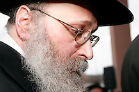 Rabbi Yona Matusof, director of Chabad House of Madison, Wis., reflects during the traditional Chasidic wedding of his daughter Chanie Matusof to Nissi Gansbourg in Middleton, Wis.<br /> <br /> Client: Wisconsin State Journal<br /> © Michael Forster Rothbart<br /> www.mfrphoto.com <br /> 607-267-4893 o 607-432-5984<br /> 5 Draper St, Oneonta, NY 13820<br /> 86 Three Mile Pond Rd, Vassalboro, ME 04989<br /> info@mfrphoto.com<br /> Photo by: Michael Forster Rothbart<br /> Date: 3/2008    File#:  Canon 20D digital camera frame 3286