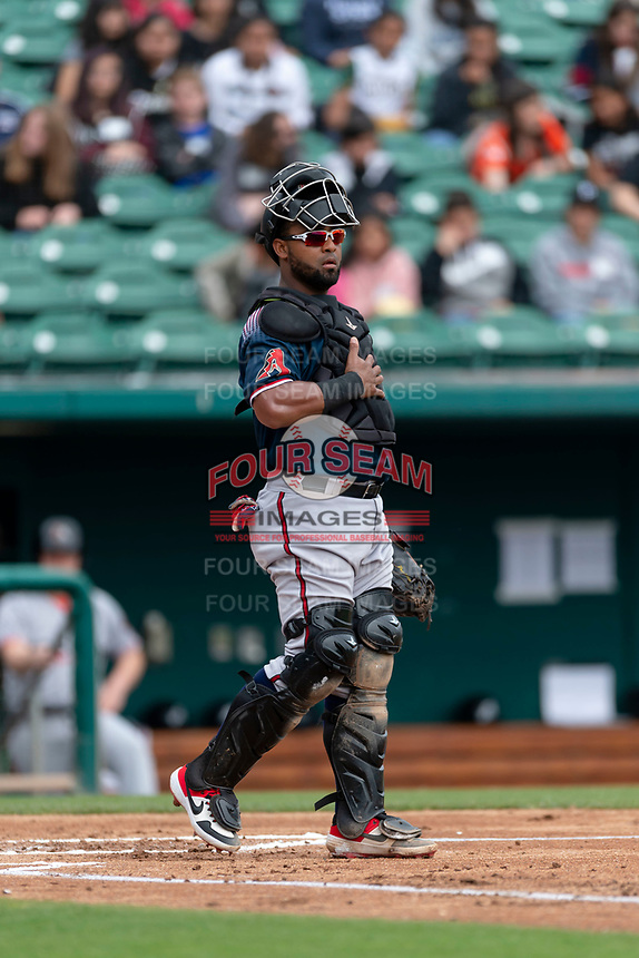 Reno Aces catcher Alberto Rosario (6) during a game against the Fresno Grizzlies at Chukchansi Park on April 8, 2019 in Fresno, California. Fresno defeated Reno 7-6. (Zachary Lucy/Four Seam Images)