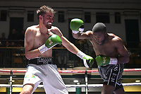 Derrick Osaze (silver shorts) defeats Callum Ide during a Boxing Show at York Hall on 6th October 2018