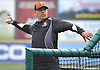 Kevin Baez, Long Island Ducks manager, tosses batting practice during a team workout at Bethpage Ballpark in Central Islip, NY on Friday, April 14, 2017.