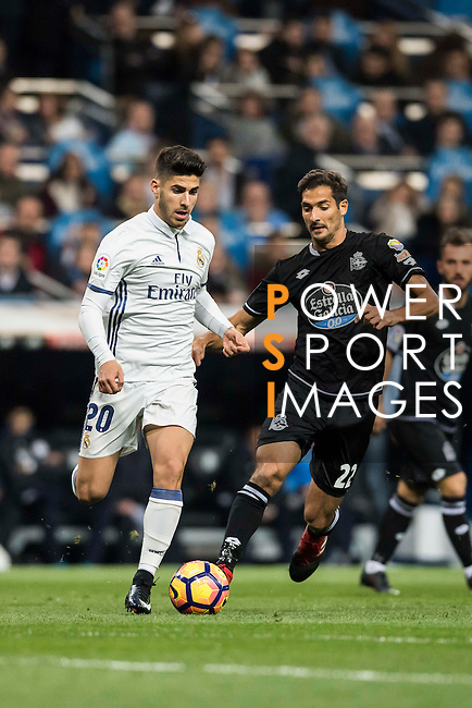 Marco Asensio Willemsen (l) of Real Madrid battles for the ball with Celso Borges Mora of RC Deportivo La Coruna during the La Liga match between Real Madrid and RC Deportivo La Coruna at the Santiago Bernabeu Stadium on 10 December 2016 in Madrid, Spain. Photo by Diego Gonzalez Souto / Power Sport Images