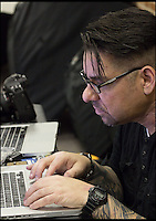 BNPS.co.uk (01202 558833)<br /> Pic: ReneRodriguez/BNPS<br /> <br /> ***Must use full byline***<br /> <br /> Rene works on the shoot.<br /> <br /> This may look like an ornate Mexican sugar skull but a closer inspection reveals it is actually made up of cleverly painted people.<br /> <br /> The incredible artwork is comprised of seven nude women who have each been covered in sparkling white body paint and brightly coloured patterns.<br /> <br /> When the models all get into position they form a perfect sugar skull - the brightly coloured icon of the Day of the Dead festival, a Mexican tradition.<br /> <br /> The idea for the eye-catching piece was thought up by Rene Rodriguez, a photographer in Los Angeles, USA.