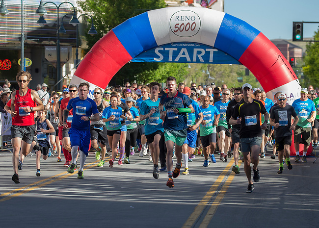 Participants start the 5K portion of the Downtown River Run on Sunday, April 30, 2017 in Reno, Nevada.