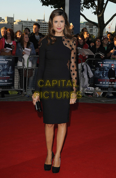 "LIVIA GIUGGIOLI .The ""Tinker, Tailor, Soldier, Spy"" UK premiere, BFI  Southbank cinema, Belvedere Rd., London, England..September 13th, 2011.full length black dress polka dot sheer panel side.CAP/CAN.©Can Nguyen/Capital Pictures."