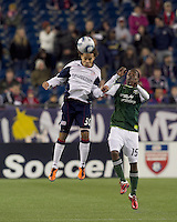 New England Revolution defender Kevin Alston (30) and Portland Timbers forward Jorge Perlaza (15) battle for head ball. In a Major League Soccer (MLS) match, the New England Revolution tied the Portland Timbers, 1-1, at Gillette Stadium on April 2, 2011.