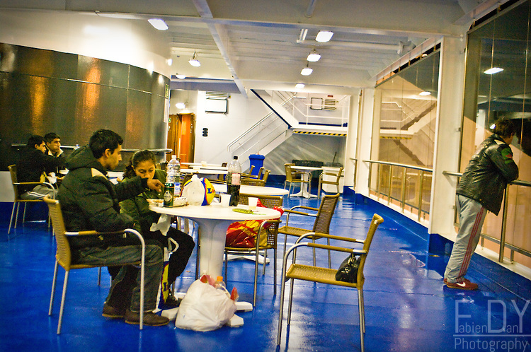 Passengers on the deck of the ferry between Bari and Patras, winter 2009