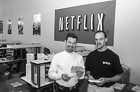 Reed Hastings, left, CEO and Co-founder of Netflix, speaks with Eric Schultz, manager of the new Phoenixville, Pennsylvania distribution center, Wednesday, February 12, 2003, in Phoenixville, Pennsylvania. Netflix plans to open one to two facilities per month for the remainder of 2003 as part of its ongoing strategy to provide one-day movie delivery to its members. By year-end 2003, Netflix expects that it will be able to reach more than 70 percent of its subscribers with generally next-day service. (Photo by William Thomas Cain)