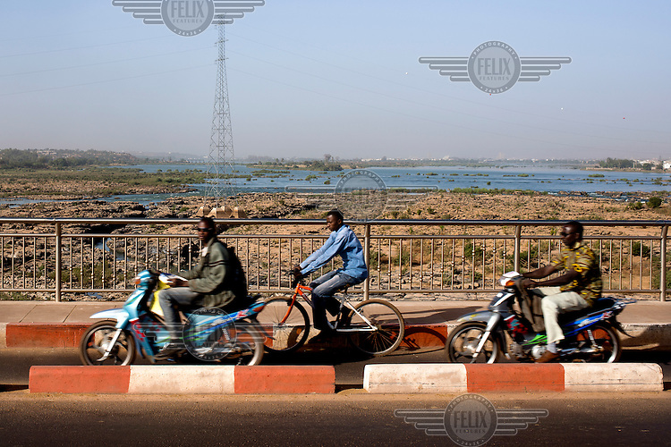 Traffic crossing the Niger River over a Chinese built bridge that was opened in September 2011 and is the third crossing of the Niger in Bamako.