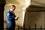A trader types his mobil at the entrance of the New York Stock Exchange where Goldman Sachs Group Management discusses Q4 2011 results in New York, United States. 13/01/2012.  Photo by Eduardo Munoz Alvarez / VIEWpress.